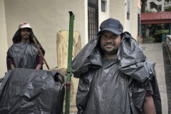 Migrant Workers with Improvised Raincoat
